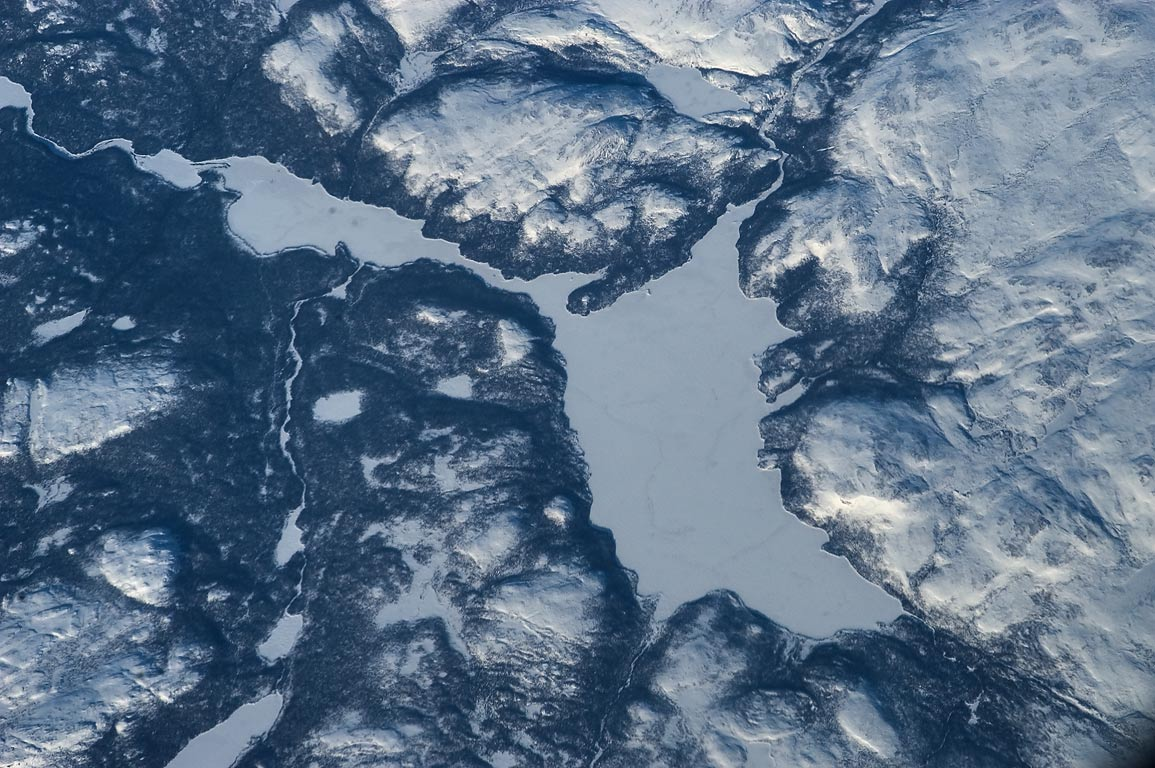 Unidentified frozen lake in Labrador, Canada, view from a plane from London to Boston