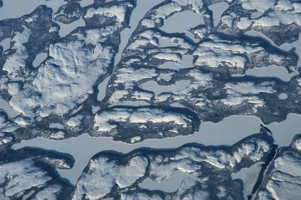 Frozen lakes and mountain ridges in Labrador...from a plane from London to Boston