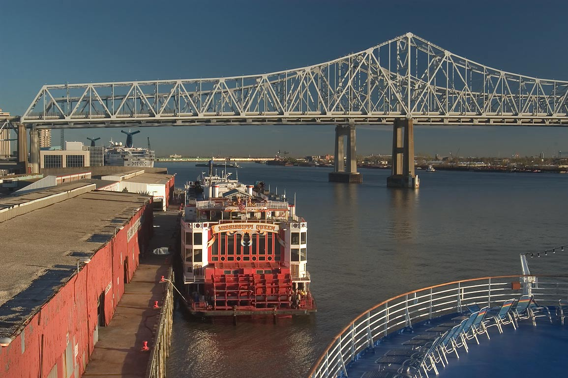 A Robin St. wharf, Mississippi River and a bridge...at morning. New Orleans, Louisiana