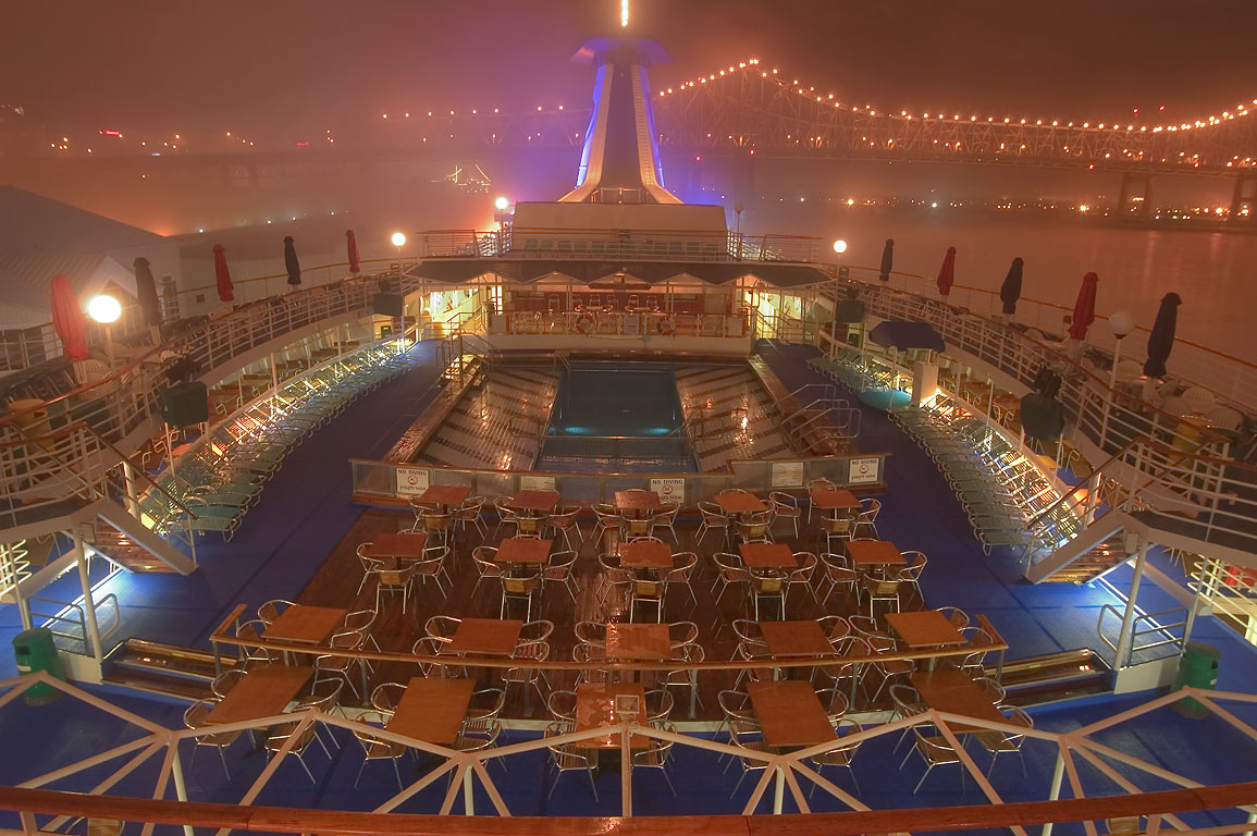 "Upper deck with a pool of cruise ship ""Dream...fog at night. New Orleans, Louisiana"