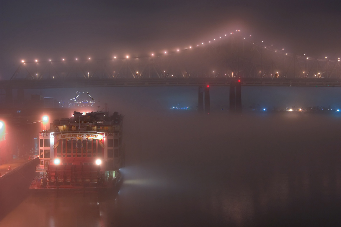 A bridge, Mississippi River, and a ship...fog at night. New Orleans, Louisiana