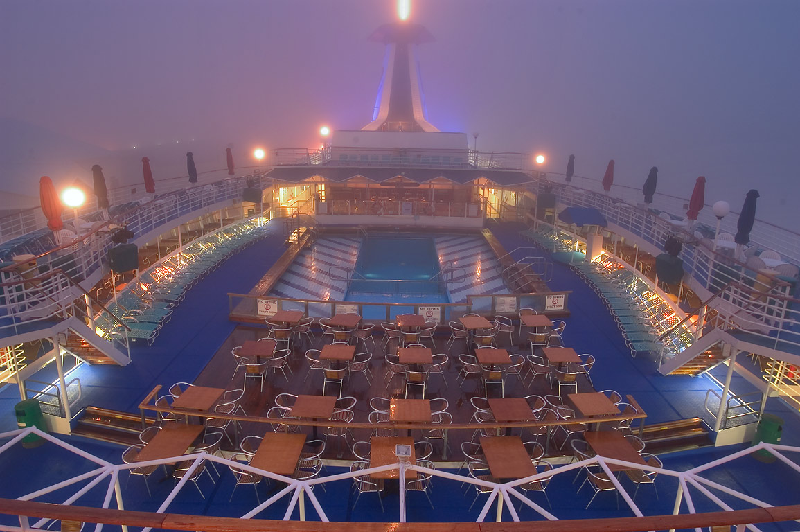 "Upper deck with a pool of cruise ship ""Dream...fog at morning. New Orleans, Louisiana"