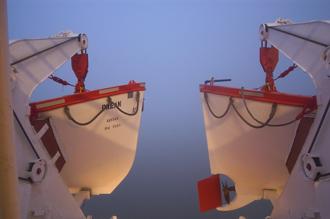 Two lifeboats from a middle deck of cruise ship...fog at morning. New Orleans, Louisiana