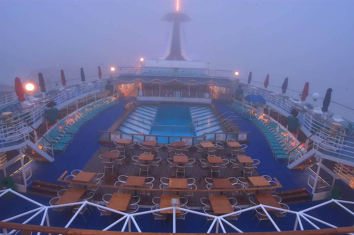 Upper deck with entertainment facilities and a...fog at morning. New Orleans, Louisiana