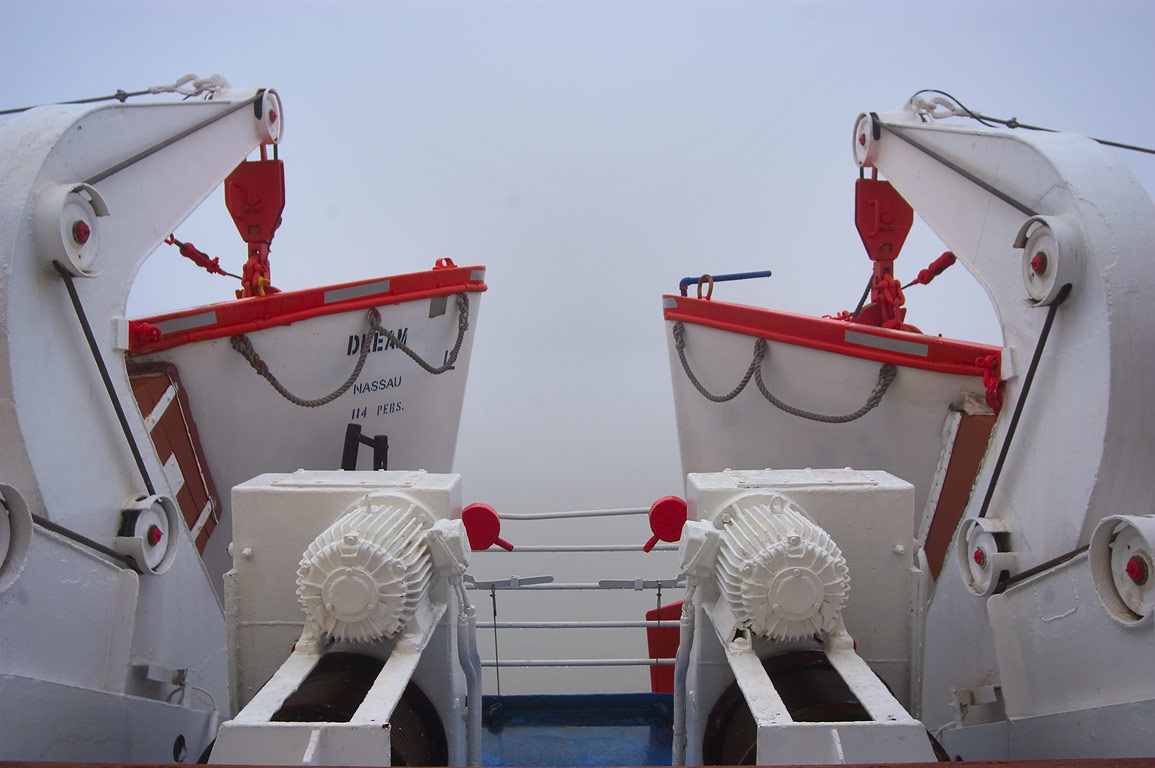 Two lifeboats with release motors from a middle...fog at morning. New Orleans, Louisiana