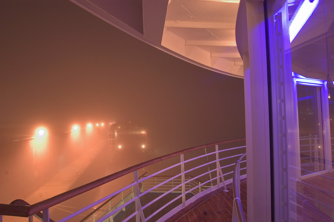 "Lit windows of a gym of cruise ship ""Dream...fog at evening. New Orleans, Louisiana"
