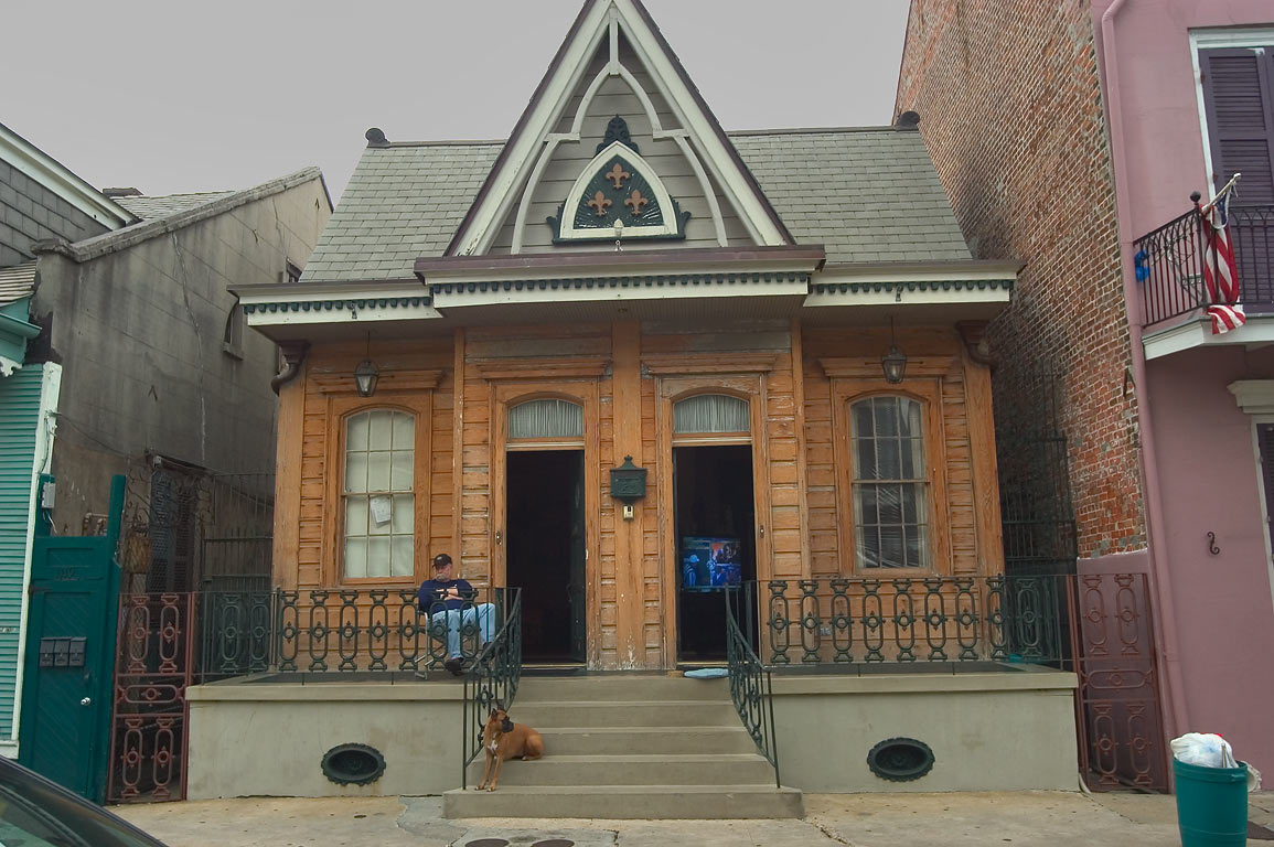 A double Gothic revival style shotgun house with...French Quarter. New Orleans, Louisiana