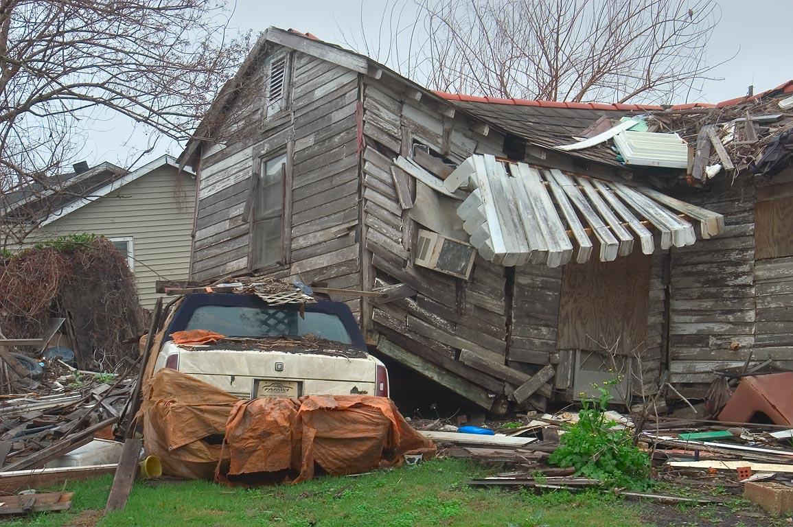 A deformed house deposited on a car near...Ninth Ward. New Orleans, Louisiana