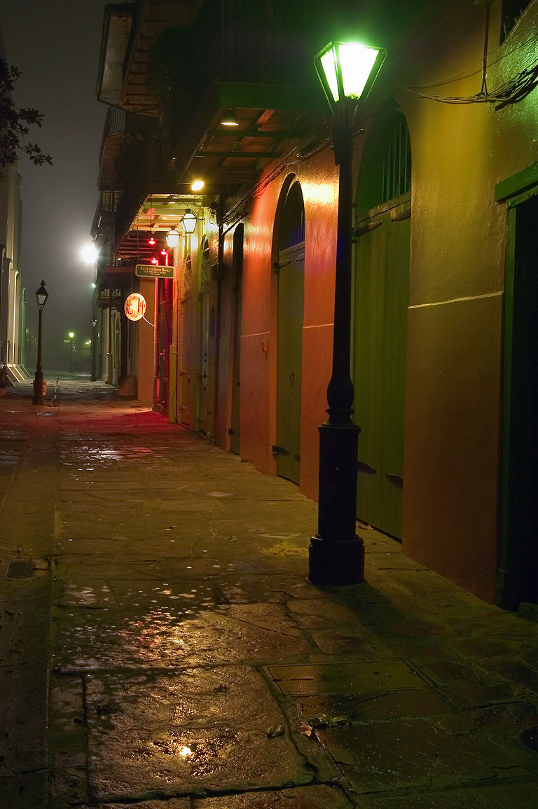 Pirates Alley in French Quarter in light fog, at early morning. New Orleans, Louisiana