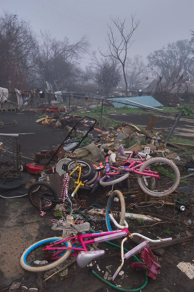Children's bicycles and Mardi Gras beads remained...fog at morning. New Orleans, Louisiana
