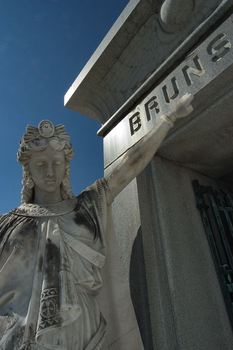 A marble statue on left side of mausoleum of...Cemetery. New Orleans, Louisiana