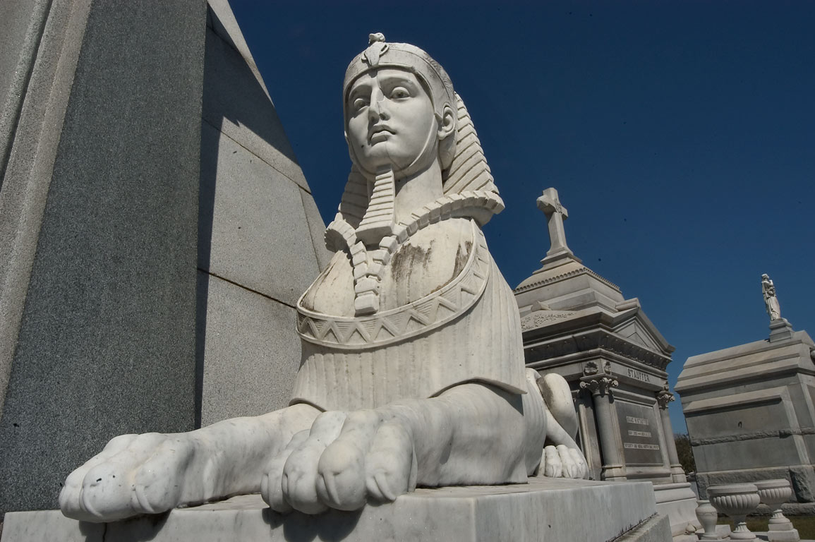 Egyptian styled marble sphinx on right side of...Cemetery. New Orleans, Louisiana