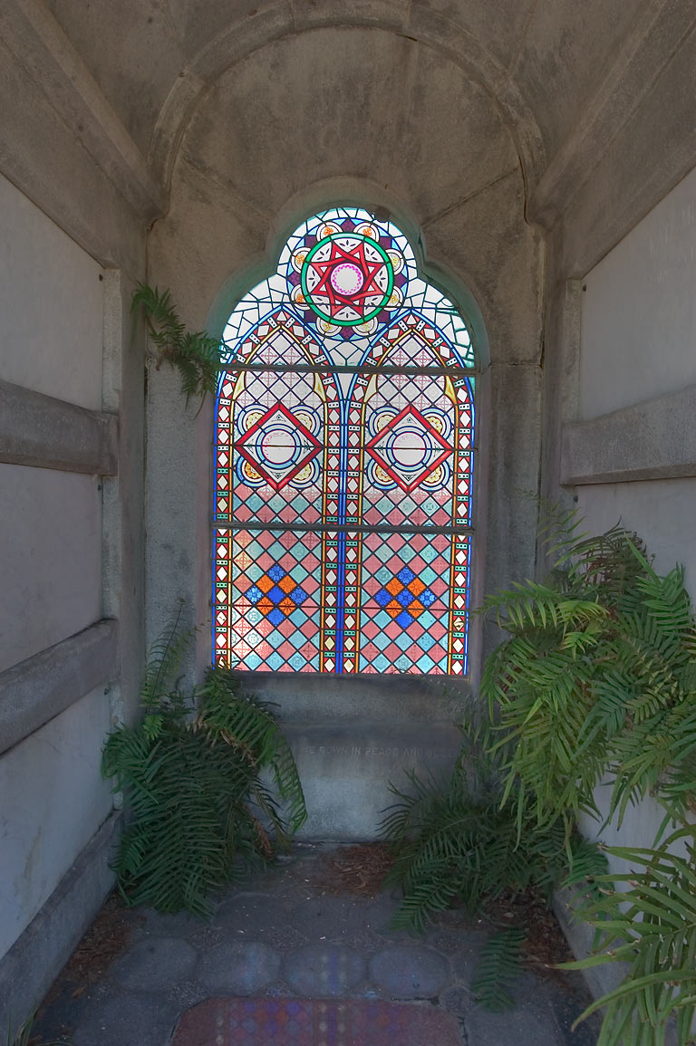 Stained window of a tomb of David C. McCann in Metairie Cemetery. New Orleans, Louisiana