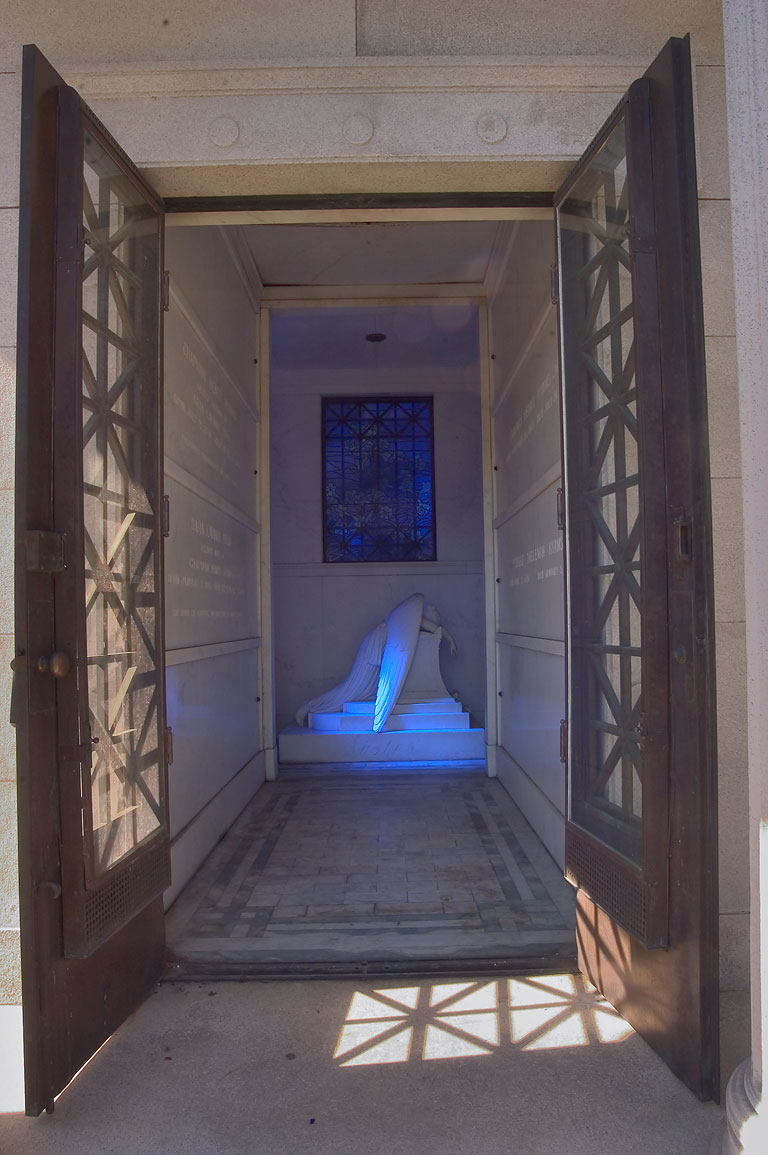 A tomb of Chapman H. Hyams with a blue weeping...Cemetery. New Orleans, Louisiana