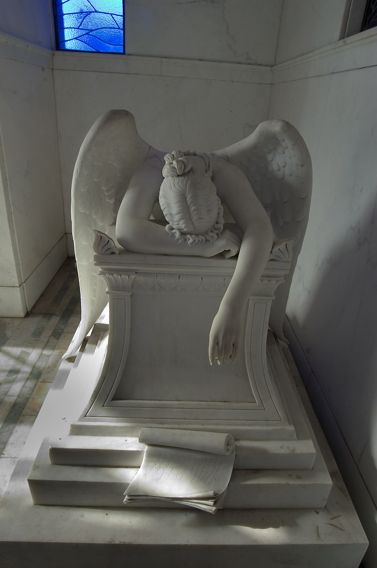 A marble sculpture of weeping angel in a...Cemetery. New Orleans, Louisiana