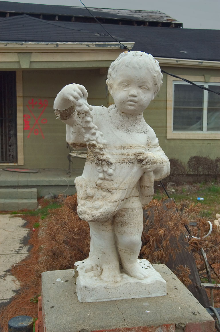 Waterline on a sculpture and a house at St...Ninth Ward. New Orleans, Louisiana