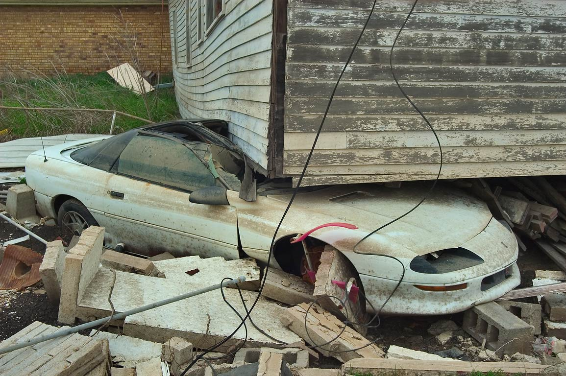A house deposited on a car at Law St. in Lower Ninth Ward. New Orleans, Louisiana