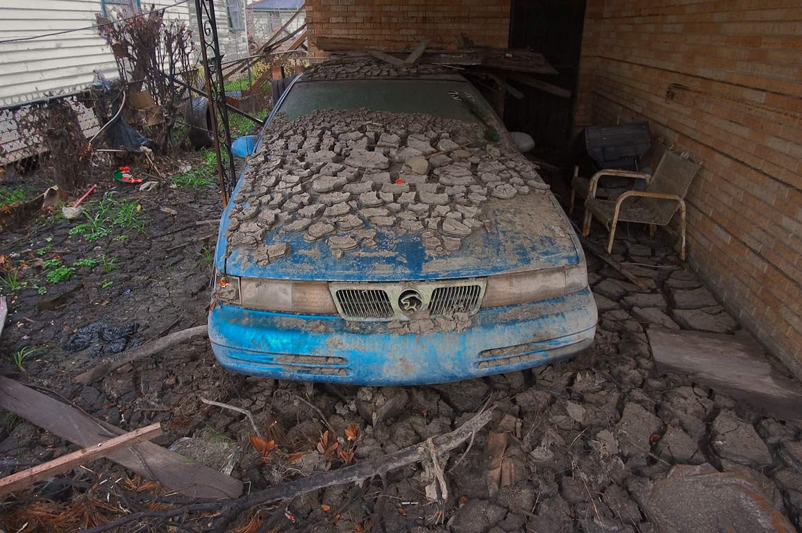 A dried silt on a car in a garage at Reynes...Ninth Ward. New Orleans, Louisiana