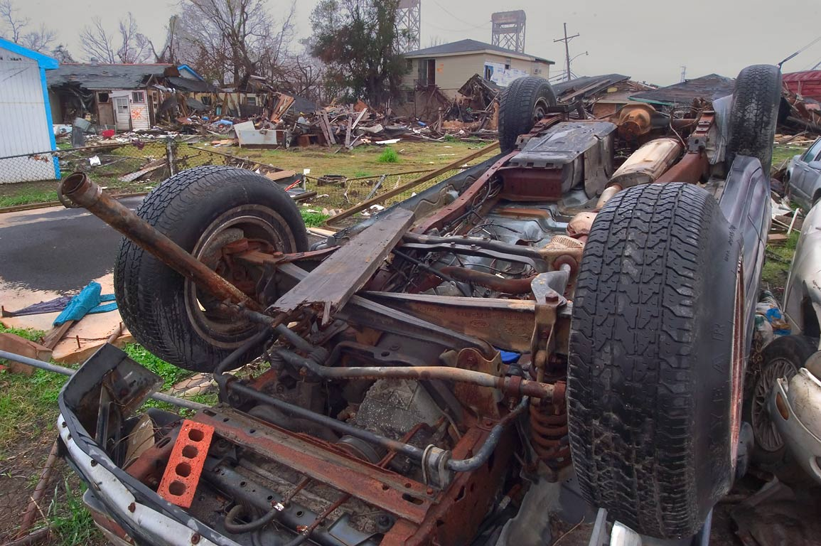 Upturned car on Deslonde St. in Lower Ninth Ward. New Orleans, Louisiana