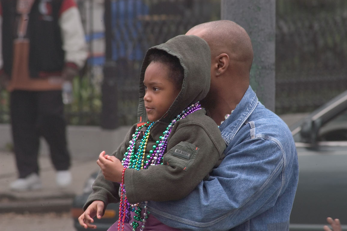 Spectators with beads at Mardi Gras parade of...Charles Ave.. New Orleans, Louisiana