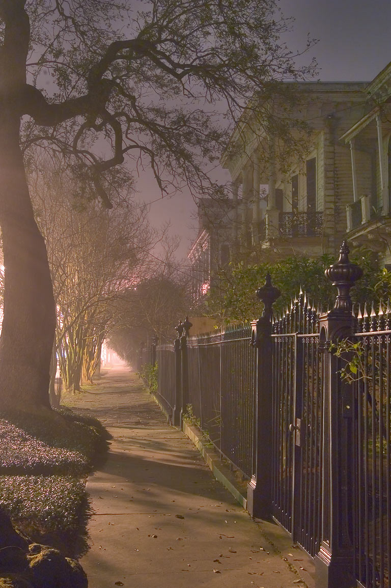 Sidewalk in fog of Jackson Ave. near Prytania St...at night. New Orleans, Louisiana