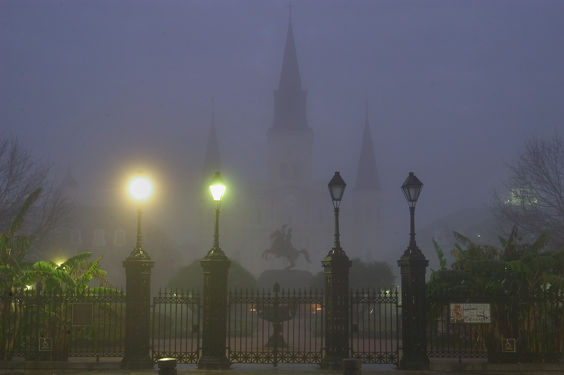 Decatur St. gate, Jackson equestrian statue, and...morning in fog. New Orleans, Louisiana