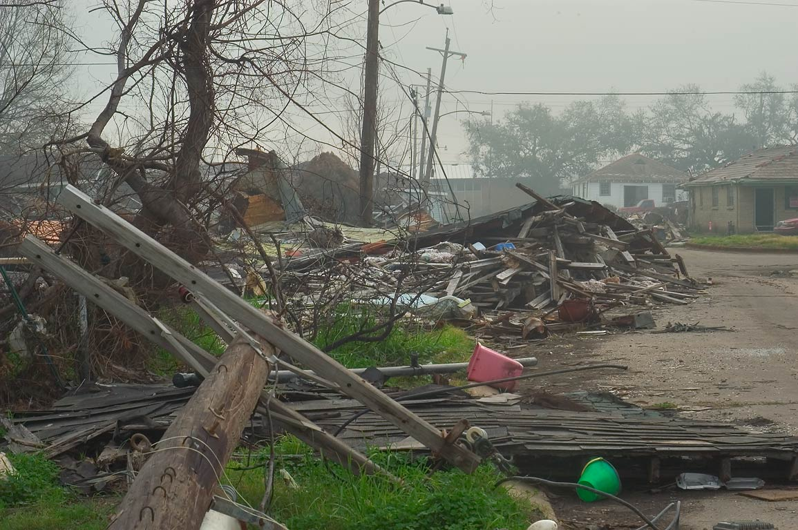 A broken electric pole and a house at North...in mist. New Orleans, Louisiana