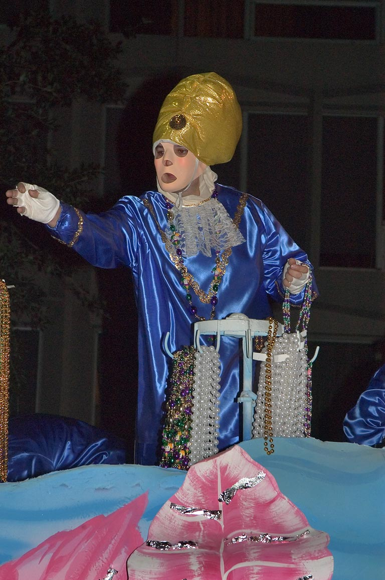 A bead thrower on a float of krewe of Chaos at...Charles Ave.. New Orleans, Louisiana