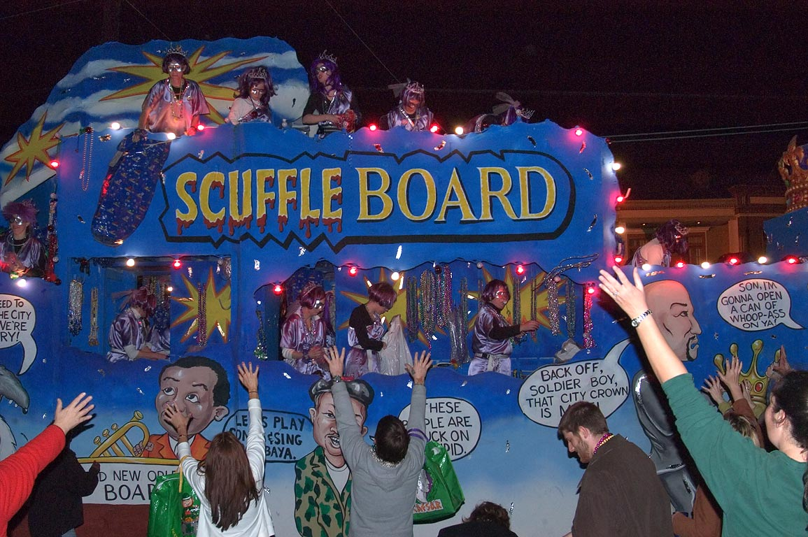 "Scuffle Board"" float of krewe of Muses at Mardi...Charles Ave.. New Orleans, Louisiana"