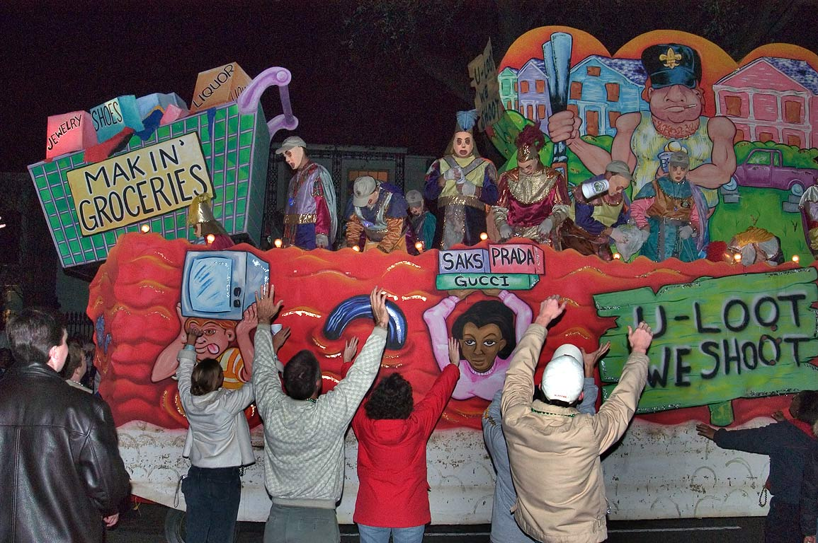 Greeting of looter's float of krewe of D'Etat at...Charles Ave.. New Orleans, Louisiana