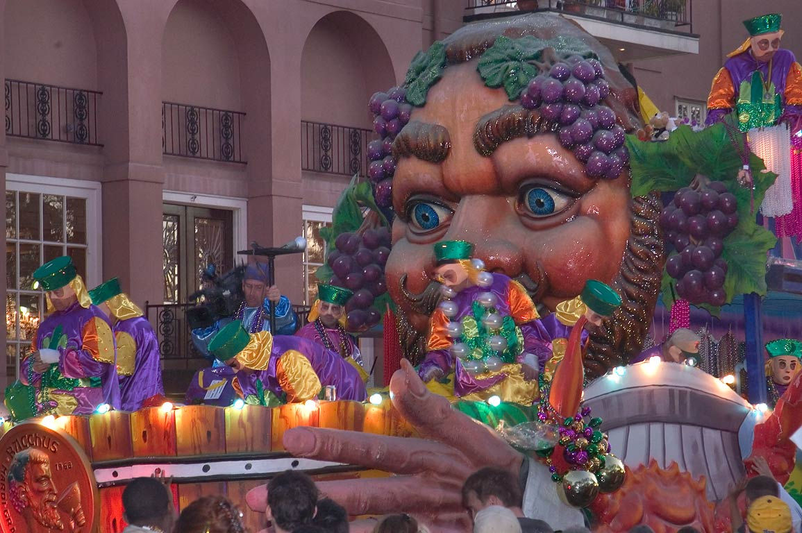 Bowl of wine float at Mardi Gras parade of krewe...Charles Ave.. New Orleans, Louisiana