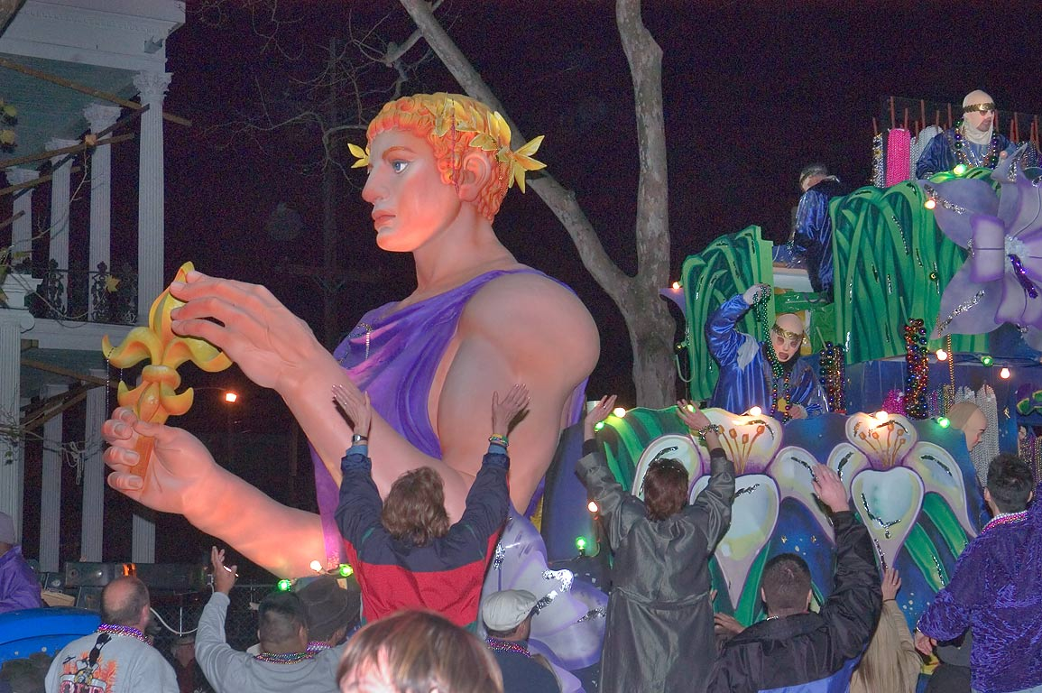 Greeting a float of krewe of Endymion at Mardi...Charles Ave.. New Orleans, Louisiana