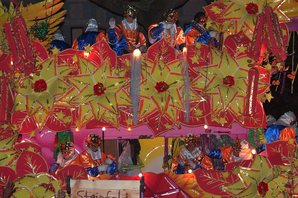 Orange float of krewe of Orpheus at Mardi Gras...Charles Ave.. New Orleans, Louisiana