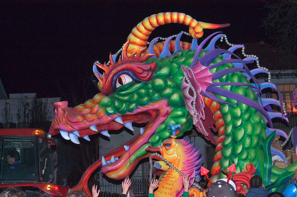 Green dragon float of krewe of Orpheus at Mardi...Charles Ave.. New Orleans, Louisiana