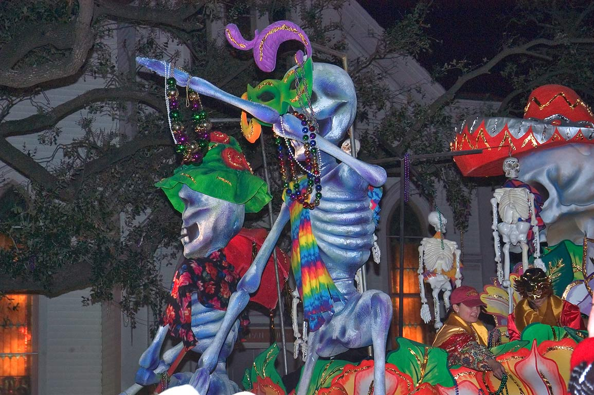 Blue skeletons float of krewe of Orpheus at Mardi...Charles Ave.. New Orleans, Louisiana