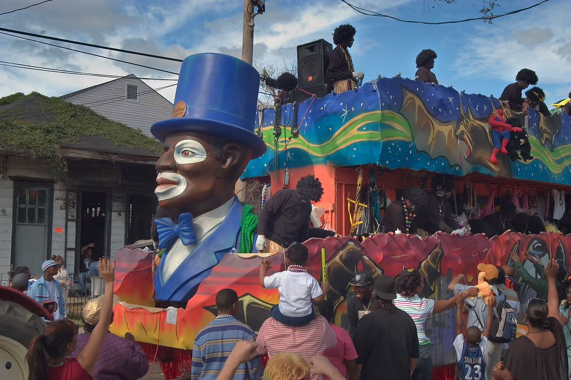A float of krewe of Zulu at Mardi Gras parade on...in background. New Orleans, Louisiana