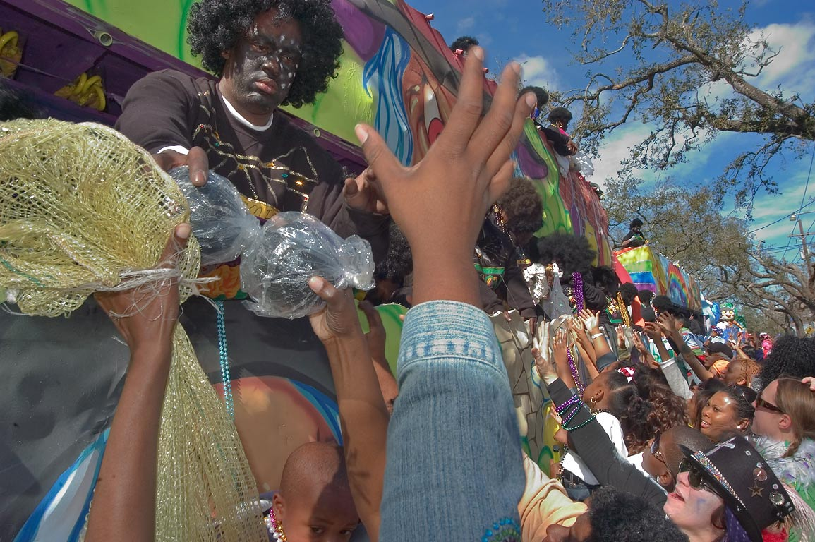 Giving out gifts and beads from a float at Mardi...Jackson Ave.. New Orleans, Louisiana