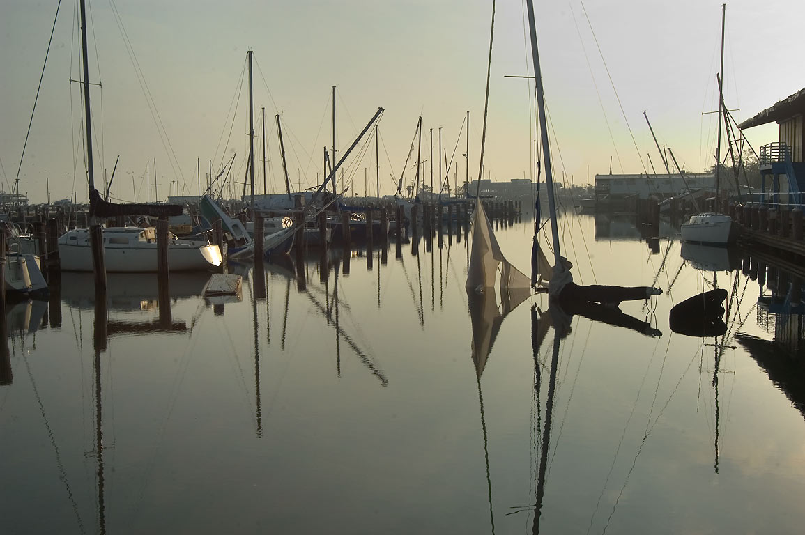 Sunken yachts in West End Marina near Breakwater...at morning. New Orleans, Louisiana