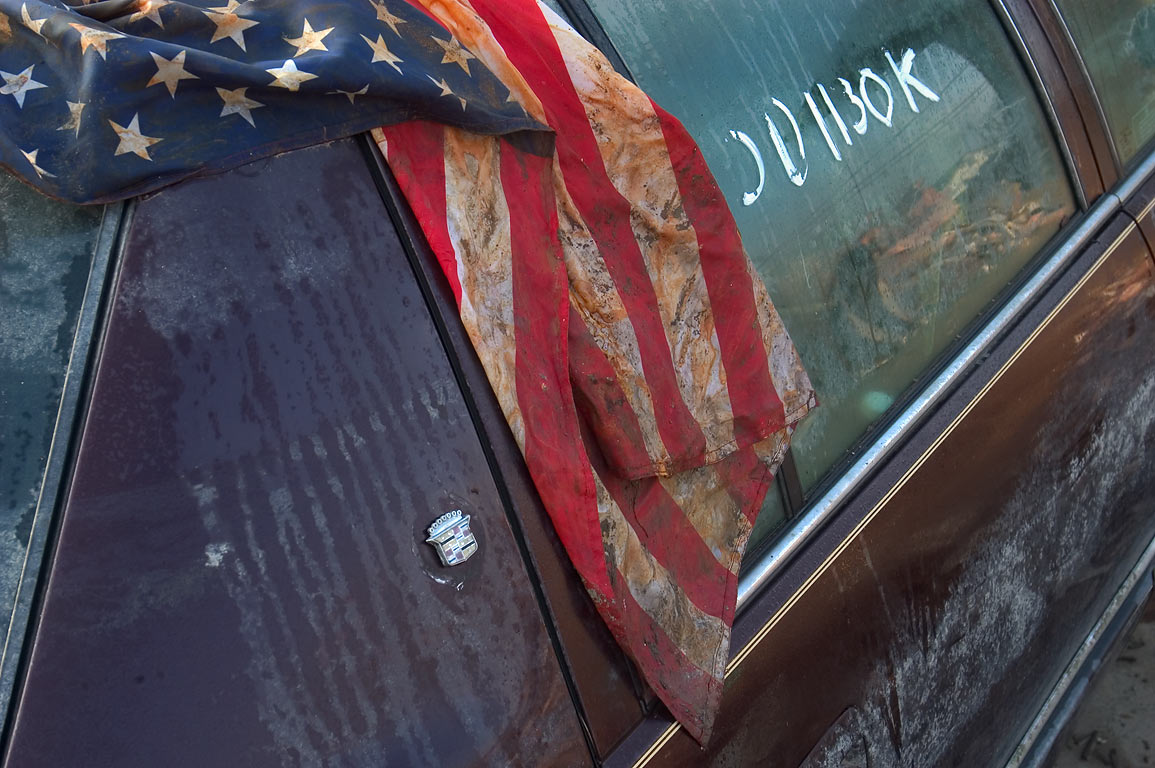 A junk car with a flag in area of Forstall St. in Lower 9th Ward. New Orleans, Louisiana