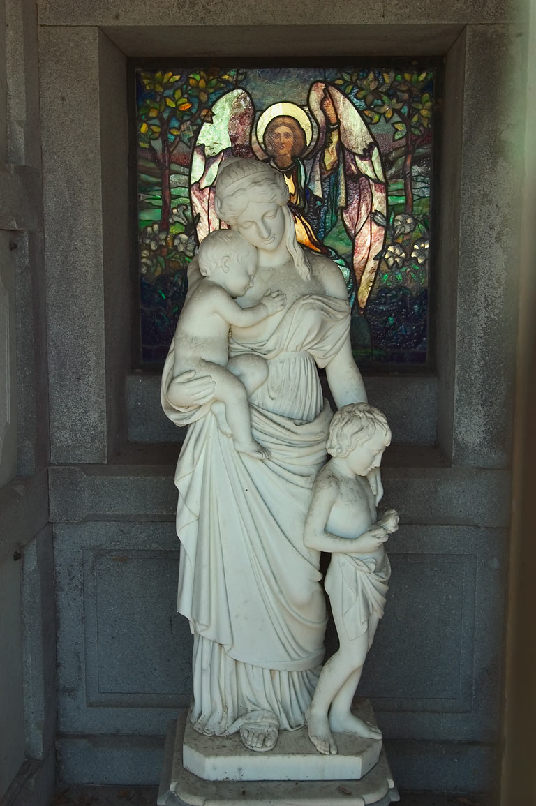 A marble sculpture in a crypt in Metairie Cemetery. New Orleans, Louisiana