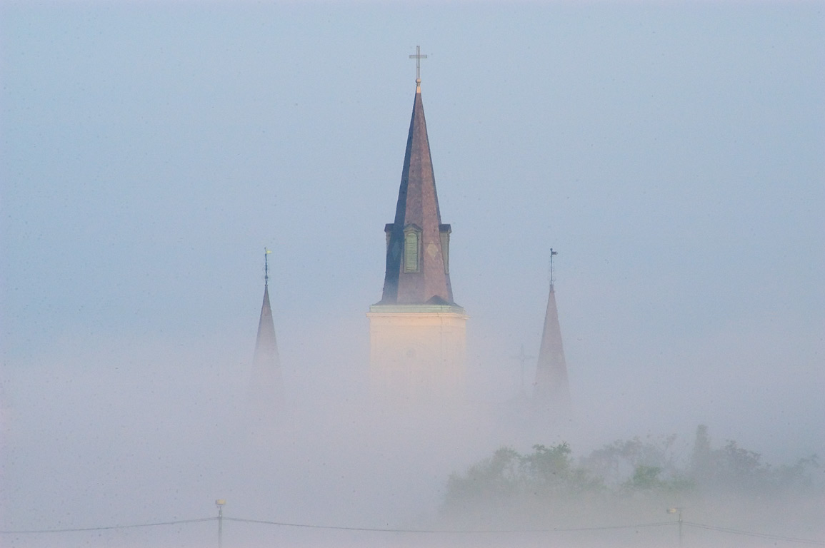 St.Louis Cathedral in morning mist, view from a...Bank) in mist. New Orleans, Louisiana