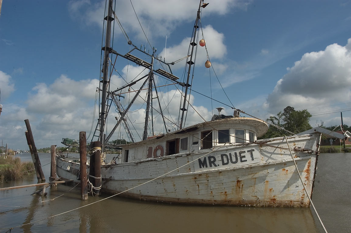 "Mr. Duet"" fishing boat in Bayou Lafourche near Golden Meadow, view from Rd. 1. Louisiana"