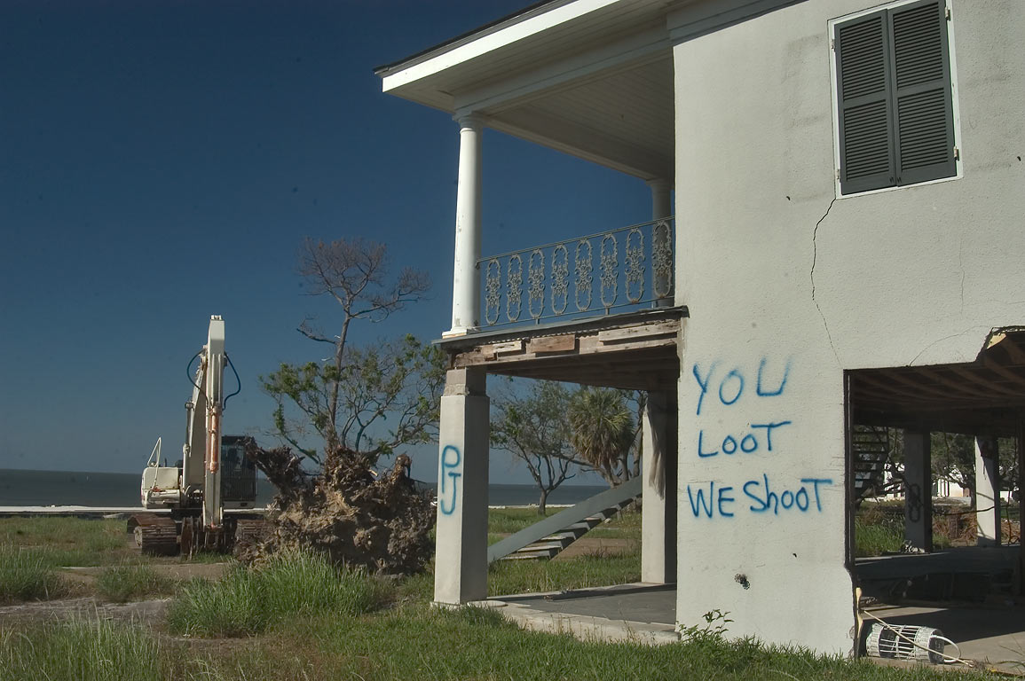 A house with gulf view and a warning for looters at Rd. 90 near Gulfport. Mississippi