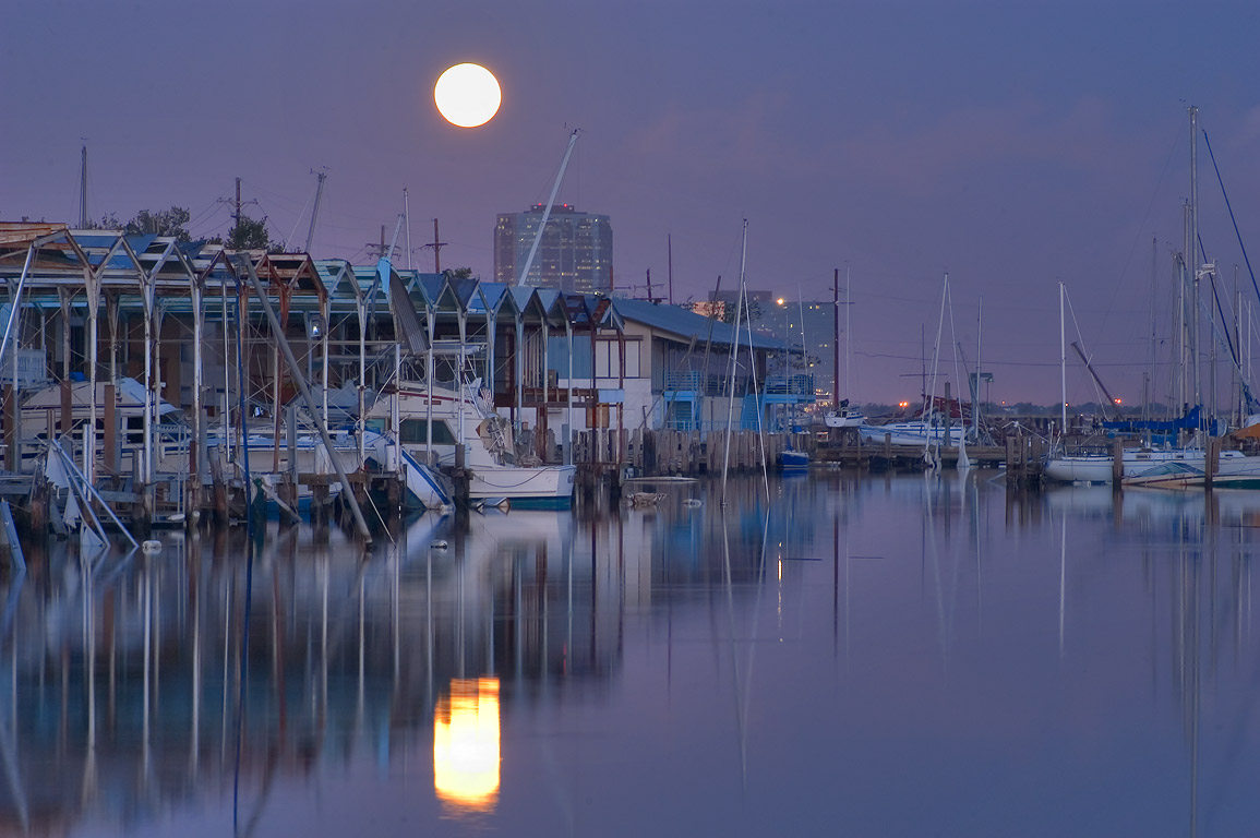 Moonset over City Yacht Club, view from North...in West End. New Orleans, Louisiana