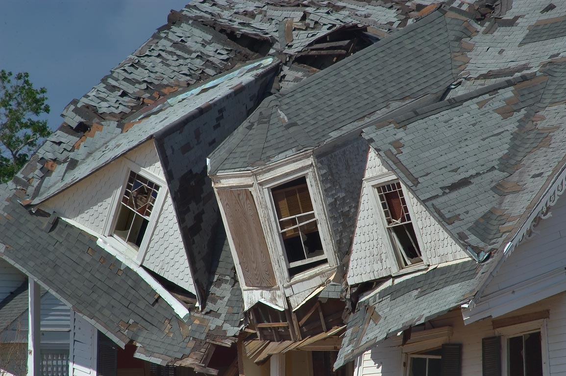 A damaged roof of Old McDonald-Websters House...Blvd. in Bay St.Louis. Mississippi