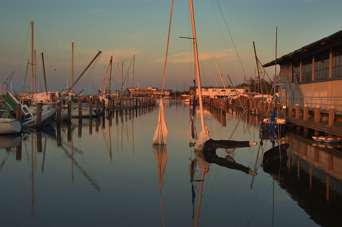 Boat graveyard in City Yacht Harbor in West End at sunset. New Orleans, Louisiana