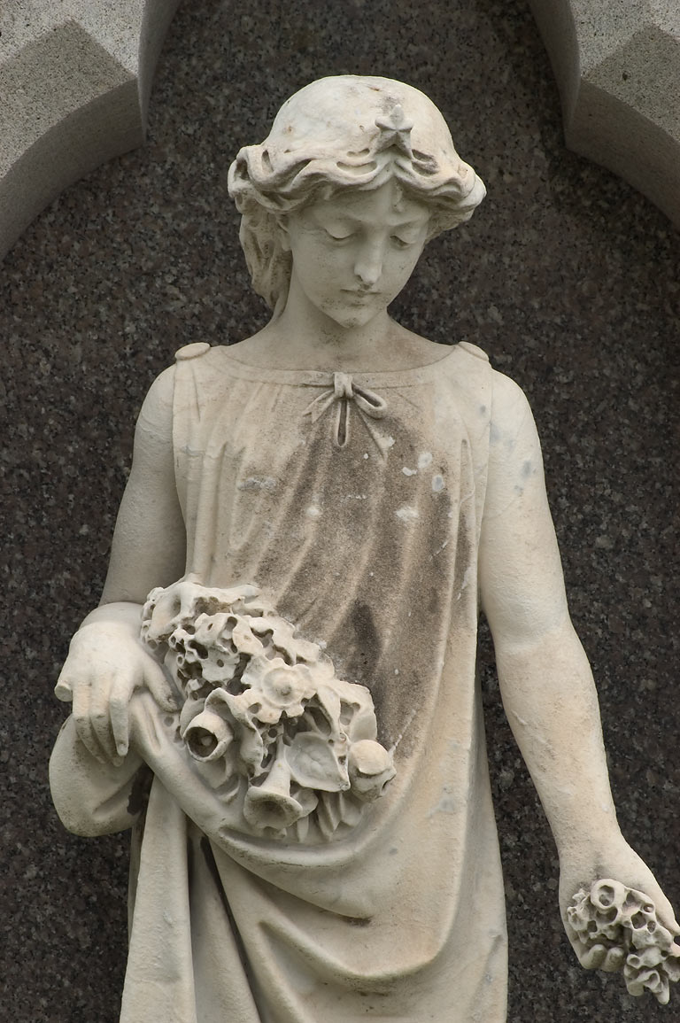 A sculpture on a tomb of David Bidwell in Metairie Cemetery. New Orleans, Louisiana