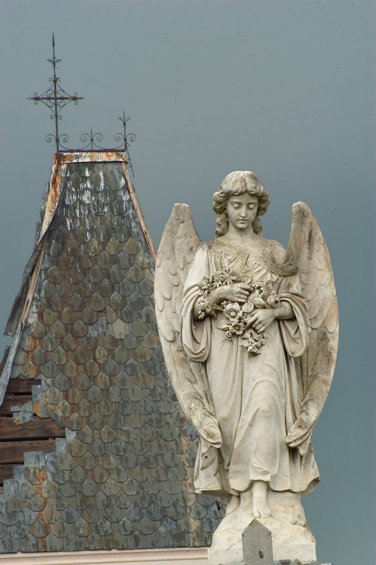 An angel on a tomb of G. V. del Corral, with a...Cemetery. New Orleans, Louisiana