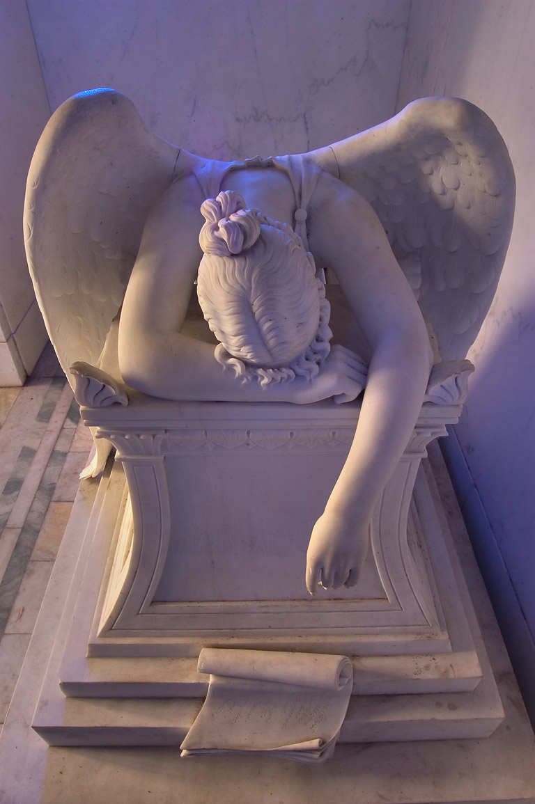 Head side of a blue weeping angel in a crypt of...Cemetery. New Orleans, Louisiana