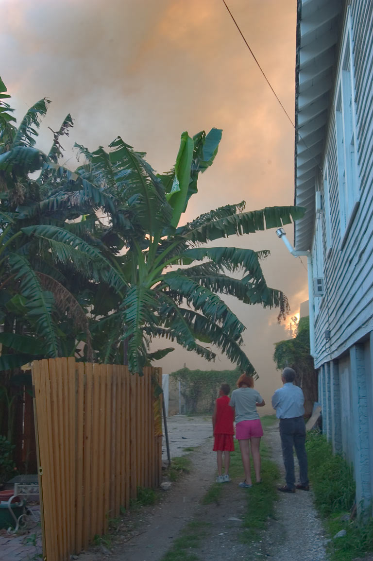 Neighbors watching a fire from their backyard at...District. New Orleans, Louisiana